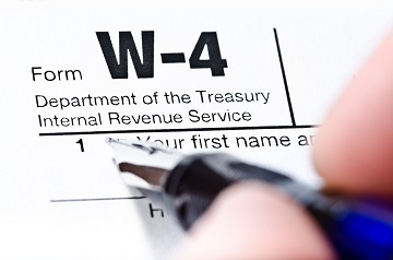 The Process Of Filling Out The W-4 Form, Shallow Depth Of Field