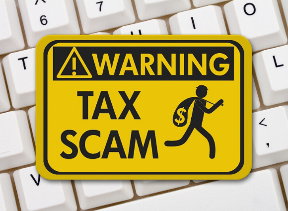 Tax Scam Sign On A Keyboard