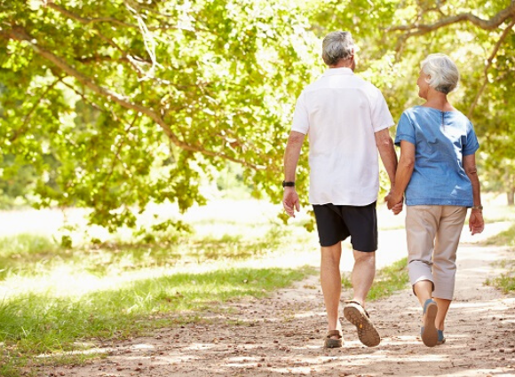 Adults Holding Hands, Walking On A Path