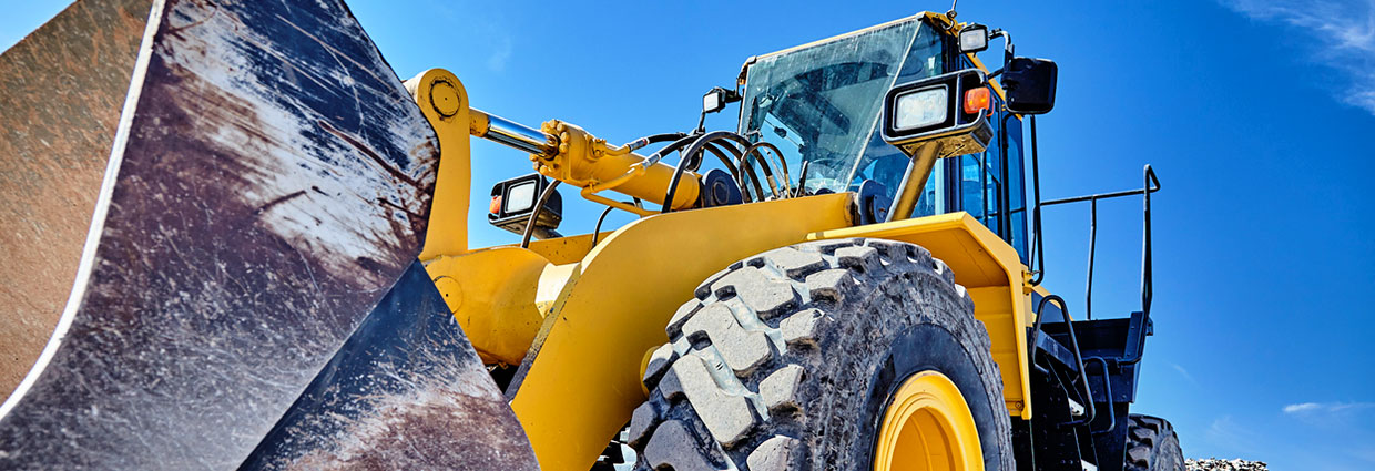 Heavy equipment machine wheel loader on construction jobsite