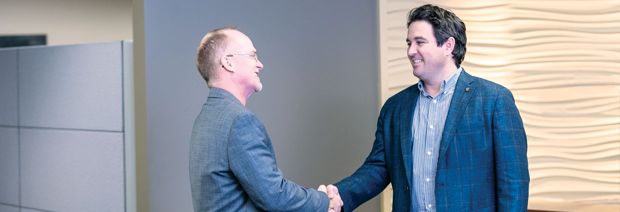 Two business men shaking hands after a meeting