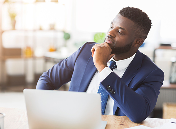 Man In Thought At Laptop