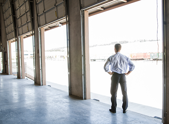 Man Standing In Loading Dock