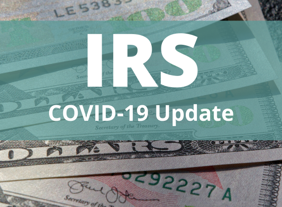 Photo Of Cash With IRS Covid-19 Update Text